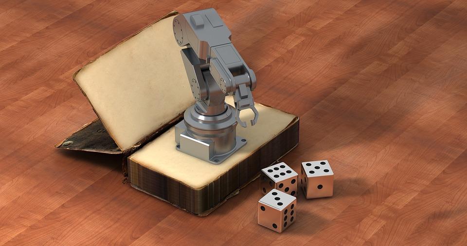 Braço robótico, dados e livro